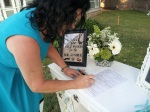 The bride's mom signs the wedding license.